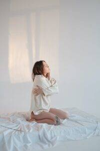 lonely woman embracing body in morning